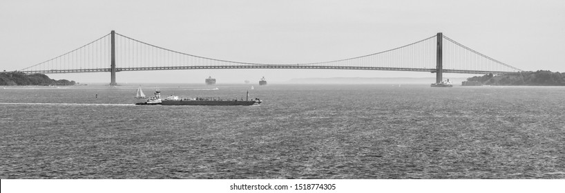 NEW JERSEY, USA - JUNE 08, 2014: The Verrazano-Narrows Bridge is a suspension bridge that boasts the longest main span in the Americas; it marks the gateway to New York Harbor.