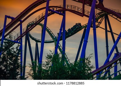 NEW JERSEY USA - JUNE 20 2016: Curves from steel and rails of the Green Lantern roller coaster at sunset. It is a stand-up coaster located in the Six Flags Theme Park in New Jersey, United States.