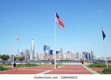 New Jersey, USA - May 23, 2018: Flying USA flag at the waterfront park in Central Railroad of New Jersey Terminal represents freedom, democracy and the unity of America