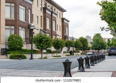New Jersey, Weehawken / USA - 06 08 2018: Urban residential neighbourhood near Manhattan, New York. Townhouses and homes, street and facade.