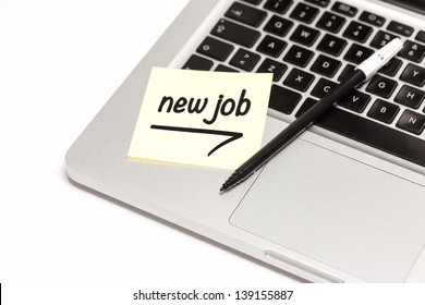 """new job"" written on sticky note, on laptop keyboard."