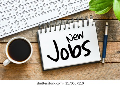 New Jobs inscription in notepad on table