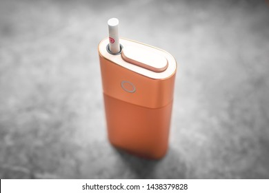 A new kind of electronic cigarette. IQOS tobacco heating system. Mod for smoking is worth of inserted cigarette. Heated cigarettes for smoking. Non-hazardous form of smoking.