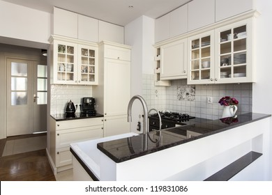 New kitchen with bright furniture and flowers