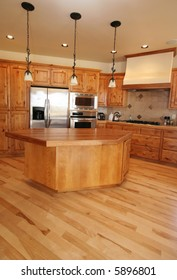 A new kitchen in a Montana home.   Maple flooring.