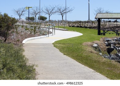 New Koombana North  parkland  landscaping  with shining chrome rails in spring in Bunbury Western Australia has beautiful views from the cycle way .