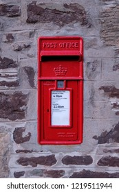 New Lanark, Scotland, UK - 11.02.2018: Red UK post box fixed into wall