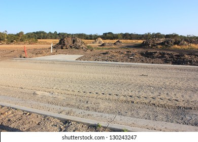 New land subdivision in suburbia with work on roads and footpaths ready to build homes