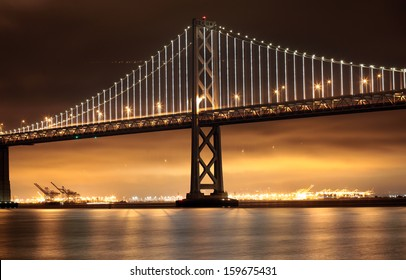 New lights illuminate the Bay Bridge connecting San Francisco and Oakland over San Francisco Bay in California.