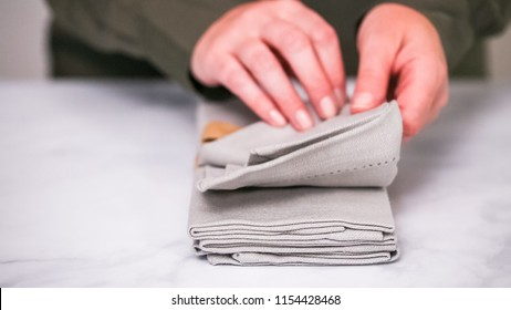 New linen dinner napkin on marble countertop.