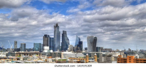 New London - Colorful HDR image of the skyline of modern London - new building and skyscrapers on blue cloudy sky - panoramic image