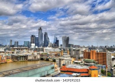 New London - Colorful HDR image of the skyline of modern London - new building and skyscrapers on blue cloudy sky