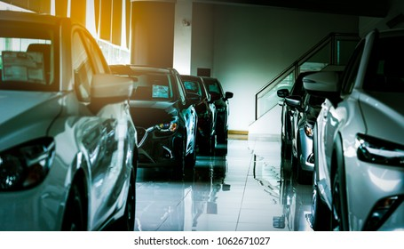 New luxury compact car parked in modern showroom for sale. Car dealership office. Car retail shop. Electric car technology and business concept. Automobile rental concept.