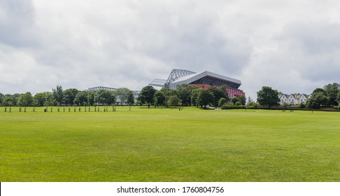 The new Main Stand at Anfield stadium seen above the line of trees which surrounds Stanley Park in Liverpool, the green space which separates the club from its blue neighbours seen in June 2020.