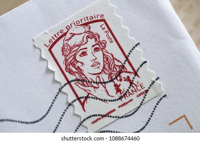 New Marianne de Beaujard red postage stamp and envelope, French letter and bright white background, Paris, France, May 2018