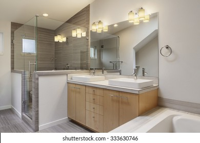 New master bathroom with lights on.