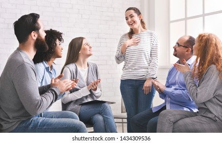 New member at rehab. Friendly people clapping at support group meeting, welcoming cheerful woman introducing herself, free space