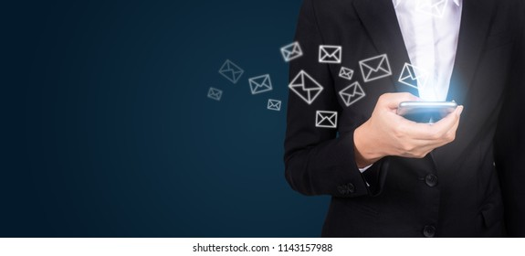 New messages on mobile phone, hands of business opening inbox to view the pending e-mail communication, copy space.