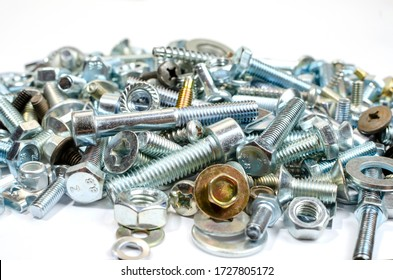 new metal bolts and nuts, washers in bulk close up