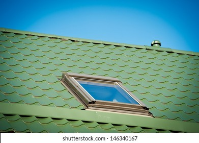 New metal roof with roof window.