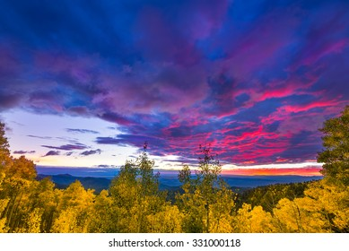 New Mexico fall mountain sunset  featuring golden aspens and colorful clouds