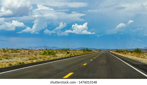New Mexico highway state route 90, northbound from Lordsburg to Silver City, Gila Mountains in the distance above heat waves on the pavement