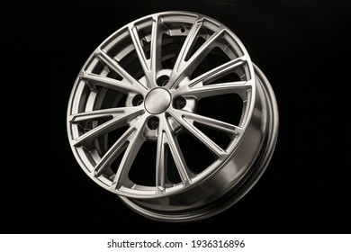 New modern alloy wheel close-up on a black background. Car beautiful