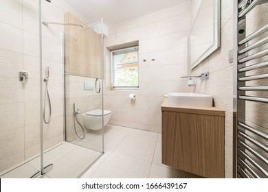 new, modern bathroom with shower in the apartment