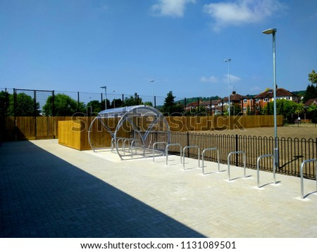 A New and Modern Bike Park with a Perspex Canopy set in Block Paving with & New Modern Bike Park Perspex Canopy Stock Photo (Edit Now ...