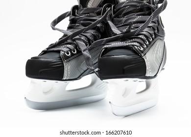 new and modern black skates on white background