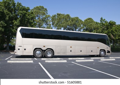 New modern bus with tinted windows waiting for passengers