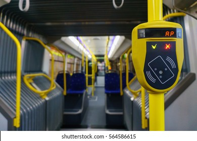 New modern cabin of city transport with yellow validator