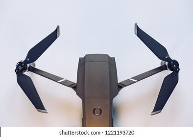 New modern drone on display on white background. Drone quadcopter with digital camera.