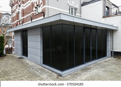 New modern extension of a house with big glasses windows and doors