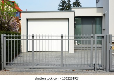 New Modern High Grade Steel Door in the Gateway to a residential Building with Concrete Car Garage