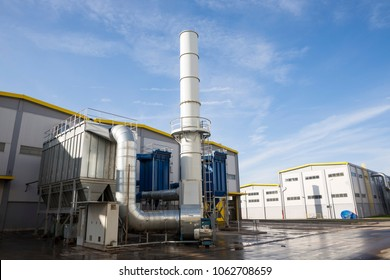 New modern industrial waste plant from the outside. Waste-to-energy plant. Produces electricity and heat directly through combustion. Produces a combustible fuel commodity.