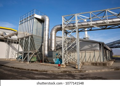 New modern industrial waste plant from the outside. Waste-to-energy plant. Produces electricity and heat directly through combustion. Produces a combustible fuel commodity, such as methane, methanol.