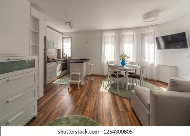 New modern living room with kitchen. New home. Interior photography. Wooden floor.