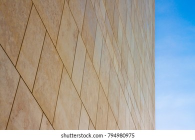 New modern ventilated stone wall made with different blocks of rectangular shape with wide joints