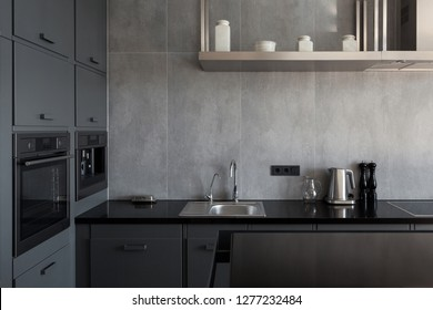 New modern white kitchen with built in oven and chrome water tap