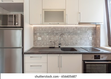 New modern white kitchen. New home. Interior photography.