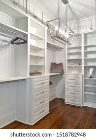 new modern white master bedroom closet with shelving and nobody display