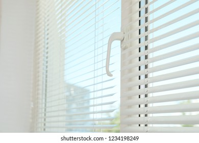 New modern window with blinds indoors. Home interior