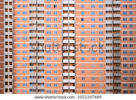 A new multi-storey house. Construction of residential apartments. Floors of the apartment house.