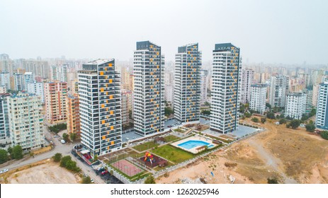 New multi-storey residential building apartment houses aerial view with swimming pool, basketball court and children playground. Mortgage background concept image.