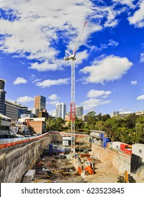 New multi-storie house contruction site from deep pit to high building crane on a sunny summer day in densly developed busy suburb of Sydney.