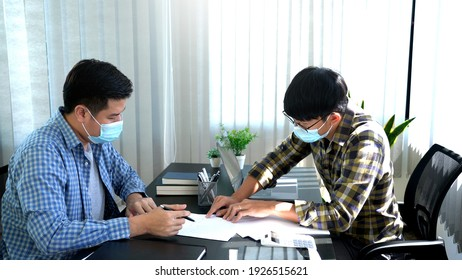 new normal business practise business people have a meeting worker wearing face protective mask at coworking space, Health and teamwork concept