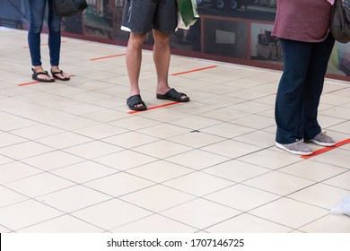 New normal lifestyle with social distancing where people are separated by a gap of at least 1 meter in queue into supermarket in Malaysia