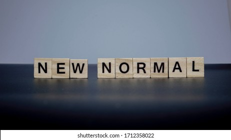 NEW NORMAL word on wooden alphabet cube. New normal after covid-19 pandemic with social distancing, good hygiene. - Shutterstock ID 1712358022