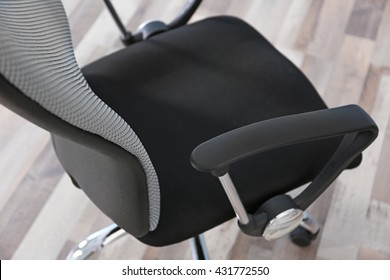 New office chair on the floor, closeup